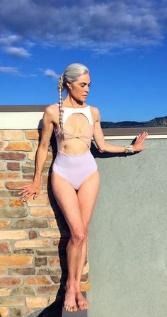 Fit and over 50. Nearly 60 years old. Bathing suit classic model Roxanne Gould. Long grey hair.