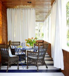 Create an Outdoor Porch Retreat Classic Comfort: This porch features a cozy nook for outdoor dining. A basic blue-and-white color palette keeps with the casual ambience. Oversize curtains partition the space to make it more intimate. Porch Curtains, Outdoor Curtains, Outdoor Rooms, Outdoor Dining, Outdoor Decor, White Curtains, Dining Area, Small Dining, Small Sunroom