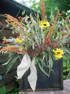 Fall dried arrangement with burlap bow  $24