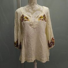 Anthropologie Lithe Peasant Blouse Top 14 Size 14 gently used worn 2 or 3 times peasant top from Anthropologie brand Lithe.  Lovely embroidery at neck and sleeves. Anthropologie Tops Blouses