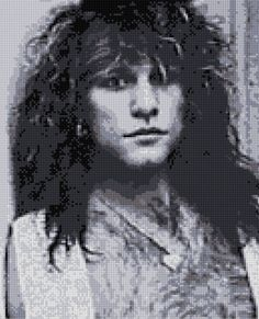 Gorgeous black and white portrait of Jon Bon Jovi taken backstage.  Our charts are unlike any other available!  Each color is on a separate page that only shows a symbol where that color is to be stitched. The rest of the chart on that page is blank. Youll be amazed how easy it is! A second complete chart is also included with all symbols together just like other commercial charts. You are actually getting two charts in one!  This chart uses 9 DMC colors and the finished size is 130 x 160…