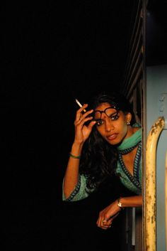 Darjeeling Limited - love the juxtaposition of the sari/glasses/cigarette!