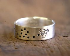 Sterling silver stamped bee, fly, or bug ring. This little bumble bee, dragon fly, or lady buy is buzzing around a simple sterling silver band ring. Busy from a day of collecting food, these insects have found his/her way onto a ring.  Each ring is handmade just for you! So they will be slight variations from ring