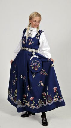 "Blue ""Grafferbunad"" with embroidered waist and skirt from Lom, Gudbrandsdalen, Oppland, Norway (I don't think the belt is originally a part of this bunad. The bunad also have a hat, but the model doesn't wear it) Folk Clothing, Historical Clothing, Traditional Fashion, Traditional Dresses, Norwegian Clothing, Frozen Costume, Ethnic Dress, Folk Costume, Ethnic Fashion"