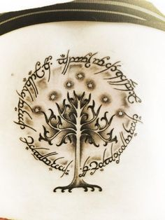 Lord of the rings tattoo. Inscription on the outside of the ring and the tree of gondor