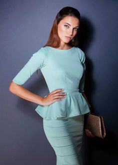 Designed and made by brand Caroline Mode Pure. - 2 piece outfit: Fitted bodice with pleated peplum and a fitted pencil skirt - 3/4 Sleeve length - Knee length skirt- Model featured is 1.80 meters/ 5'9 feet -Material: 97% polyester, 3% lycra -wais
