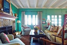 Teal serves as the primary shade in this living room | archdigest.com