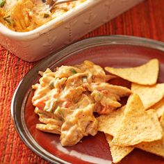 Warm Chicken Fiesta Dip Recipe -This crowd-pleasing dip is always a success, whether I follow the recipe as is or if I substitute shredded pork and stir in chopped fresh mushrooms.—Shannon Arthur, Lucasville, Ohio