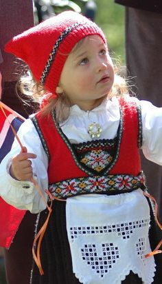 Cute little girl in traditional costume (bunad) from Hordaland county, Norway.