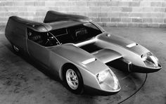 OSI Silver Fox concept (1967). Renault Alpine 4-cylinder engine mounted in the left-hand side of the vehicle, behind the passenger seat. Capable of reaching 155 mph. Between the two fuselages were three individual spoilers. The front one was manually adjustable when the vehicle was stationary. The middle one could be adjusted while on the move while the rear spoiler was in a fixed position.