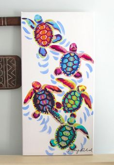 COLORFUL ACRYLIC SEA TURTLES PAINTING -Hand painted on a 12×24 canvas A completely original and unique creation that makes for a perfect gift or room decoration! Canvas is attached to 1/2 inch thick wooden frame. It can be hung up as is for a contemporary look or framed to suit your decor. **$5 from every purchase will be DONATED to the Wildlife Conservation Network to protect endangered animals and their habitats** The artist retains all reproduction rights and copyrights. Feel free to