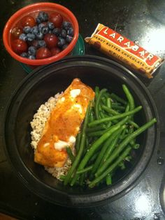 Leftover salmon (Use tempeh or tofu) with brown rice and green beans, larabar and blueberries with grapes.