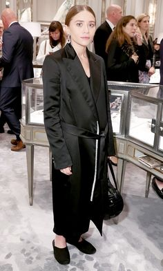 18ee4ddfe20c46 Ashley Olsen pulls off a satin pajama-inspired wrap coat and slippers  Elizabeth Olsen