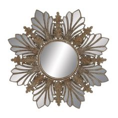 Snowflake-inspired wall mirror with a faded gold finish.   Product: Wall mirrorConstruction Material: Metal and...
