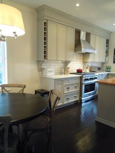 """The cabinets are painted Bedford Grey by Martha Stewart. The island butcher block is from Ikea. The counter is carrera marble. The squared pulls are Martha Stewart special order from Home Depot. The range is a 6 burner 36"""" Kitchen aid commercial style range."""