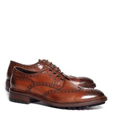 Oxford with wingtip detailing and lug sole. Genuine leather. Made in Italy.<br/><br/>Please size down one full size when ordering.