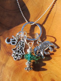 GOOD KARMA - Charm Necklace with Lucky Elephant, Hamsa, Om and Emerald Crystal dangle- Yoga Jewelry, Zen, Buddhism, Hindu, Namaste, $24.00