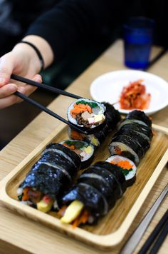 Wondering where to eat in Sapporo, Japan? From sushi to ramen to gyozas, this foodie guide includes all of the best places to eat in Sapporo! Sapporo, Kimbap, Asian Restaurants, Best Places To Eat, Plant Based Diet, Korean Food, Diet And Nutrition, Japan Travel, Food Photo