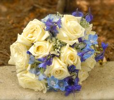 My wedding bouquet: white roses,blue hydrangea, blue delphinium, and baby's breath.... Add a little green and I am in love!!