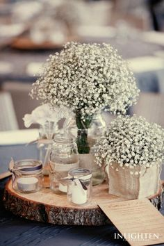 gypsophila table centrepieces with tree trunk plate - gives a taste of the Italian outdoors!