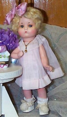 """A  little 10"""" bisque doll by the name of """"Just Me."""" Just Me was designed by Armand Marseille and later sold in the US by Vogue."""