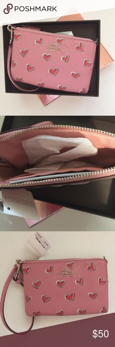 """COACH 52920 PINK HEART CROSSGRAIN LEATHER WRISTLET AUTHENTIC Brand NWT. Still in box. Features 1 open multifunction pocket, 1 credit card slot, 6"""" strap. Coach Bags Clutches & Wristlets"""