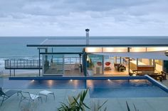 Steel and glass house. Integrated pool.