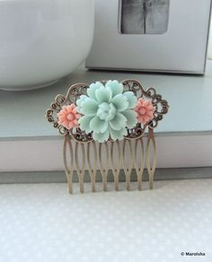 A Soft Mint Green Flower, Pink Mum Flower Collage Hair Comb, Bridesmaids Gift Wedding Comb. Vintage Style Collage Hair Comb. Country Theme. $18.50, via Etsy.