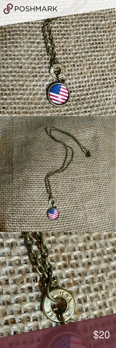 Patriotic USA 223 Bullet Necklace American Flag A unique .223 rifle round stamped USA with a flag charm.  Antique brass finish.  18-inch necklace. Jewelry Necklaces