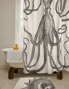 Make a large scale piece of artwork by stretching a printed shower curtain over a DIY wood frame.      [DIY Octopus Art - House of Jade Interiors Blog]