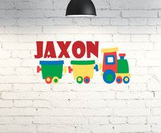 Vinyl wall art for kid's room.  Train wall decor personalized with child's name. Custom bedroom wall decal. Little boys room. Train decor by PinkPigPrinting on Etsy