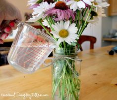 Make fresh cut flowers last longer…add 2 Tbsp white vinegar to the water in your vase and stir well. The vinegar helps inhibit the growth of bacteria and keeps your flowers fresher longer.