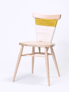Get cheap mismatched chairs at goodwill and cover the backs with yarn..love it.