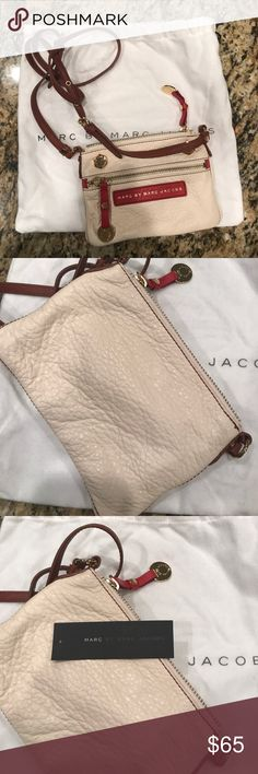 Marc by Marc Jacobs cross body leather bag Never used with tag and dust bag! 8x6 bag with adjustable strap. Gorgeous soft leather. Marc by Marc Jacobs Bags Clutches & Wristlets