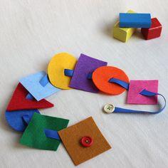 Despertar el juego actividad de abotonarse Montessori