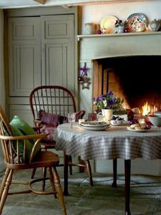 A kitchen with an open fire. Warm & inviting!