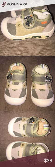 Adorable Baby Shoes Size 4 International Winner These shoes are made by Klin an International Company in Brazil famous for kids clothing and shoes. They have won many awards! These darling shoes are canvas with camo colors and look. Army Jeep on side of A