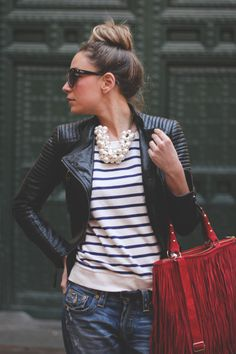 stripe tee shirt, denim jeans, red handbag, pearl chunky necklace, black leather fitted motorcycle jacket - street style