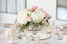 shoreshotz photography The reception table centerpieces included white hydrangeas paired with pink peonies and roses. The arrangements were placed in mercury glass vessels. Reception Venue: Wychmere Beach Club Floral Design: Kim's Times to Remember Floating Candle Holders, Floating Candles, Botanical Gardens Wedding, Garden Wedding, Wedding Reception Decorations, Wedding Centerpieces, Wedding Ideas, Wedding Tables, Reception Table