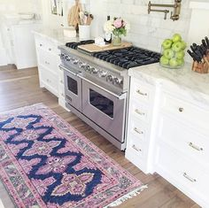 Not necessarily this rug but I like the idea of a nice rug in the kitchen for warmth and color