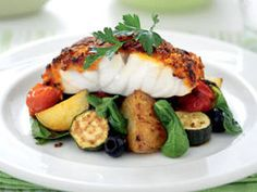 Grilled Fish with Mediterranean Vegetables - Inspiration (photo only for presentation idea, not recipe) - toss grilled vegetables in a Mediterranean dressing before serving.