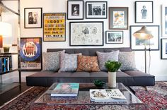 Artwork framing the couch. Create an eye catching gallery wall