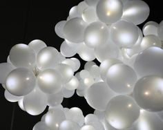 Balloon Lamp - The Balloon Lamp is a simple, elegant way to add a little style to your home, inside or out. Designed by Kouichi Okamoto, the balloon lamp uses a high-intensity LED light to illuminate whatever area you hang it in. The LED lets it run over 100 hours with the included lithium-ion batteries, and the b ...