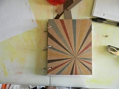 Diy Notebook from scratch, made out of chip board, scrapbook paper, and whatever paper (line, graph, blank, etc.) you want to put in it.