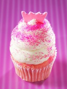 Gigi's Cupcakes - Miss Princess: White cake baked with fresh strawberries, topped with a cream cheese frosting, pink sugar crystals and a pink fondant crown.