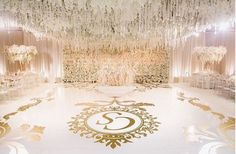 Large chandelier effect over a dance floor with gold decal
