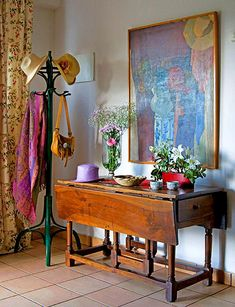 Vintage Entryway: An antique dining table, now an entry table for keys and mail. A vintage coat stand completes the look.