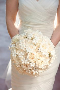 The bride held a bountiful bouquet in cream hues composed of roses and pearl-dotted stephanotis blossoms. Photography: John Solano Photography. Read More: https://www.insideweddings.com/weddings/romantic-intimate-summer-wedding-in-beverly-hills-california/354/