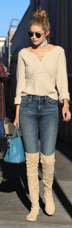 Who made Gigi Hadid's tan suede boots, lace up sweater, and blue tote  handbag