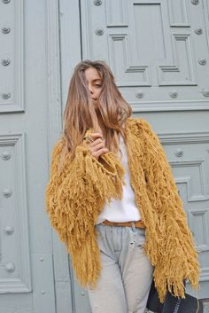 I sold a 60's vintage lime green, wool fringed vest like this one for $200 at the last Vintage Expo in L.A. This one, however, I would keep. ~ETS